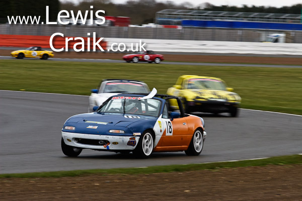 Jonathan Greensmith battling through the field - Luffield